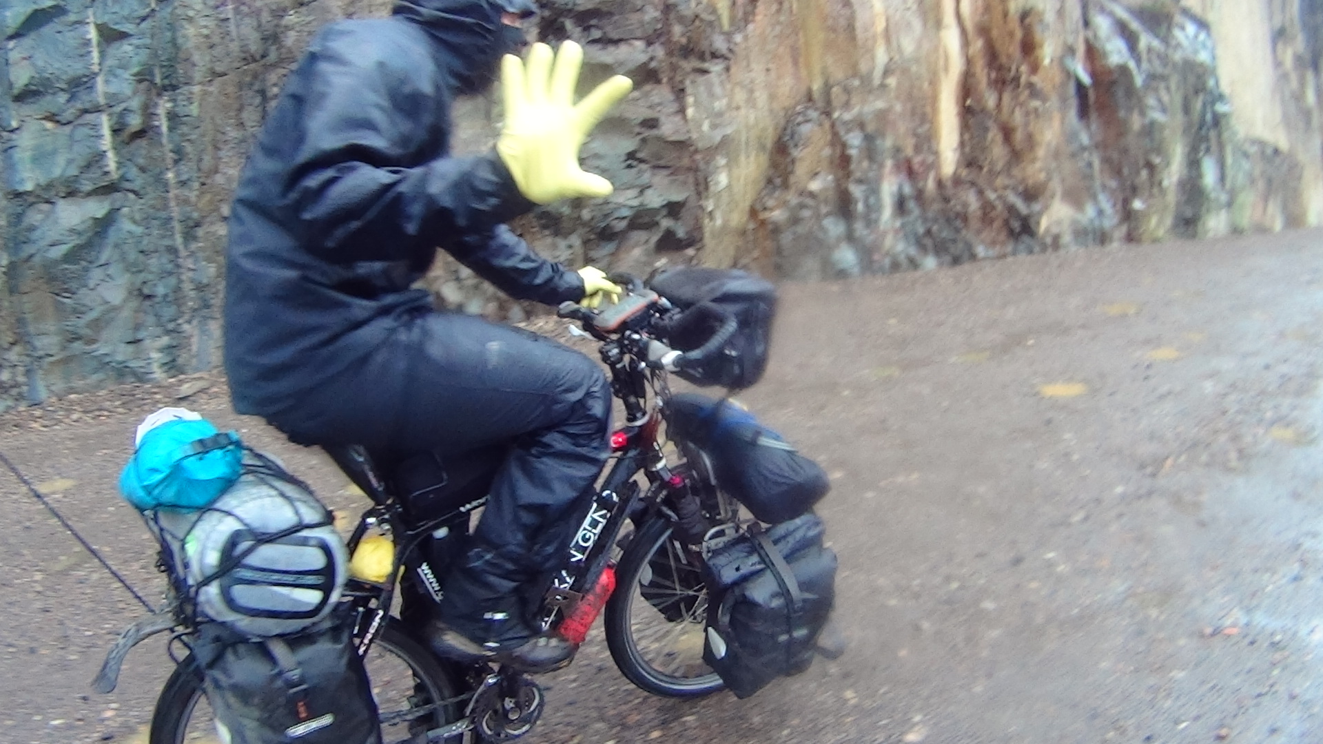 Yellow rubber gloves over inner gloves. Excellent for keeping hands dry. Why didn't I do that before? A bout of cold afternoon rain forces on full wet weather gear.
